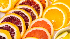 Ingredients for preparing detox citrus infused water as a refreshing summer drin Stock Footage