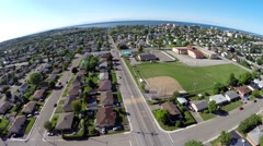 Aerial view over residential area in Rimouski on St Lawrence River 5  Stock Footage