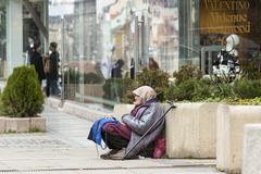 Homeless begging woman - stock photo