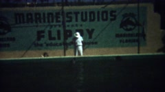 1949: Flippy the educated porpoise performs tricks at Marineland park. - stock footage