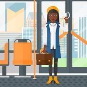 Woman standing inside public transport - stock illustration