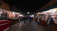 Walking on an alley between stalls at the Christmas market in Nuremberg Stock Footage