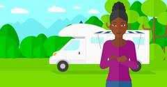 Woman standing in front of motor home - stock illustration