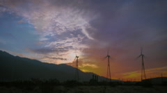 Windmill Field Timelapse with Vivid Sunset - stock footage