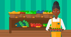 Supermarket worker with box full of apples - stock illustration
