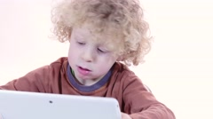 a little blond boy playing with a digital tablet - stock footage