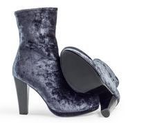 Pair of gray suede women's boots on heels - stock photo