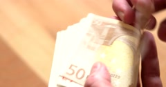 Close-Up of a Businessman's Hands Counting Euro Bills Stock Footage