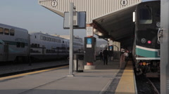 Rush hour passenger running to amtrak metrolink surfrider train - stock footage
