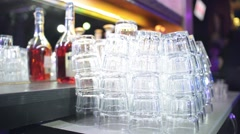 Glass faceted glasses for martinis and cocktails at the bar the night club Stock Footage