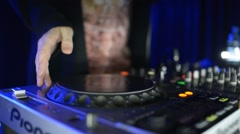 Hands Of Dj Tweak Controls On Record Deck In Night Club. Turntable, Mixer, Plate Stock Footage