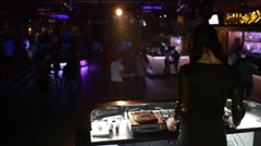 Female Dj Is Performing Her Set, people dancing In The Night Club Stock Footage