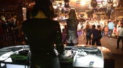 Female Dj Is Performing Her Set, people dancing In The Night Club - stock footage