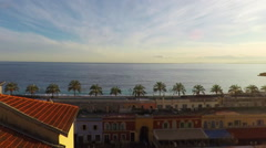 Time lapse of panoramic view of coastline and beach with old market in Nice, Cot Stock Footage
