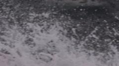Slow Motion Crashing Ocean Water on Boat Stock Footage