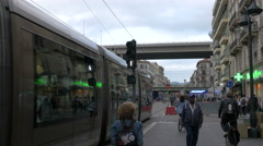 Tram passing on a street under a highway in Nice Stock Footage