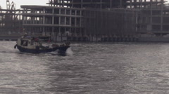 Chinese Boat in Bay with Construction Project Background Stock Footage
