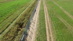 Flight over of Hungarian - Serbian border wire fence. 2015. September Stock Footage