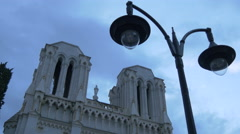 Street lamp in front of the Notre-Dame de Nice Basilica in the centre of Nice Stock Footage