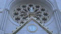 Low angle of the Notre-Dame de Nice Basilica rose window in the centre of Nice Stock Footage