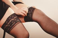 Stock Photo of Woman wearing black stockings