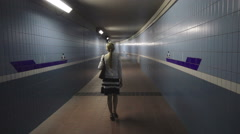 Woman is going in the underpass - stock footage