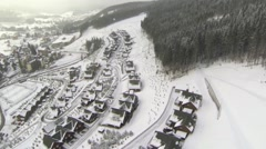 Aerial shot of houses on the hill in winter Stock Footage