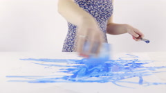 Spilling colour on paper and painting with brush 4K Stock Footage