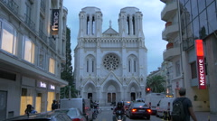 Basilica of Notre-Dame de Nice seen from Avenue Notre-Dame in the centre of Nice Stock Footage