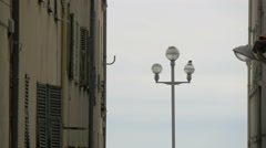 Lamp post seen from a narrow street in Nice - stock footage