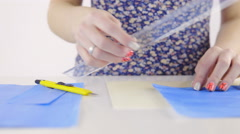 Shaping blue paper with knife and ruler 4K Stock Footage