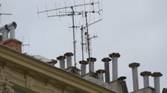 Chimneys and antennas on a building in Nice - stock footage
