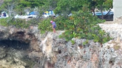 PUNTA CANA, DOMENICAN REPUBLIC JANUARY 29 Man Fishing at the coast cliffs in  Stock Footage