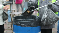 People throwing litter in waste bin, environmental pollution, global consumerism Stock Footage