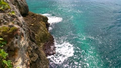 Turqoise water waves hitting rock cliffs near the city of santo domingo, dome Stock Footage