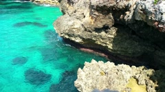 Turqoise waves hitting rock cliffs near the city of santo domingo, domenican  Stock Footage