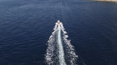 Aerial shot of navigating speed boat in the sea at full speed - stock footage