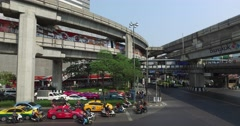 Traffic jam by day,downtown city of Bangkok,Thailand MBK mall 4k Stock Footage