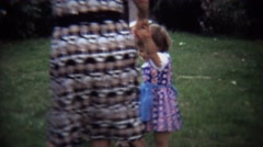 1973: Extended family circling play jumping fun with toddler child. Stock Footage