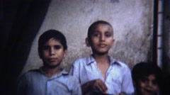 1972: Poor urban arab street kids in ancient city. Stock Footage
