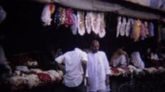 1972: Arab colorful flower market vendor slow shopping. Stock Footage