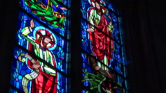 Stained glass window in a church - transition, close up, vertical pan - stock footage