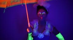 Girl in neon dancing costume Stock Footage