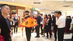 Shenzhen market promotion activities, traditional folk Gong shout patrol - stock footage
