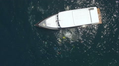 Aerial shot of scuba divers jumping from the diving boat Stock Footage
