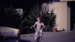1972: Blonde kid riding banana seat bike sunny suburban neighborhood. Stock Footage