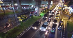 Traffic jam by night,downtown city of Bangkok,Thailand Stock Footage