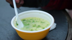 Homeless man eating portion of soup at shelter, charity support for poor people Stock Footage