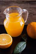Orange juice in the pitcher Stock Photos