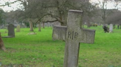 Stock Video Footage of Old Rest in piece crucifix on a cemetery RIP